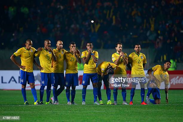 Players of Brazil look dejected in the penalty shootout during the 2015 Copa America Chile quarter final match between Brazil and Paraguay at Ester...