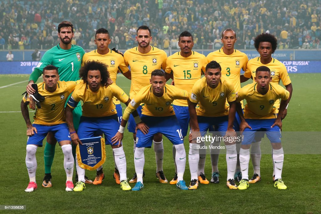 Players of Brazil pose for photographers during a match between Brazil and Ecuador as part of 2018 FIFA World Cup Russia Qualifier at Arena do Gremio on August 31, 2017 in Porto Alegre, Brazil.
