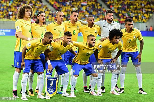 Players of Brazil pose for pictures before the start of their Russia 2018 FIFA World Cup South American Qualifiers' football match against Uruguay in...
