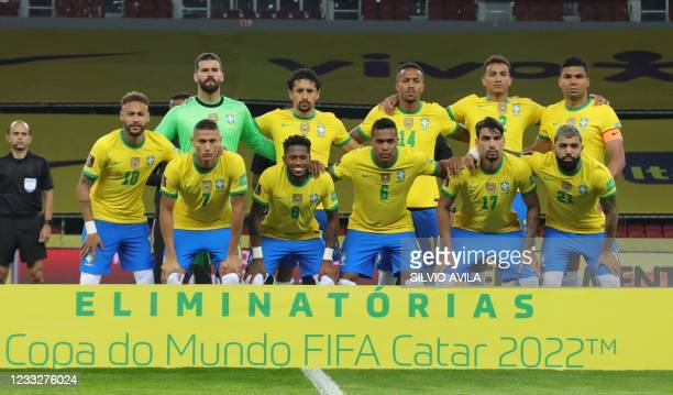 Players of Brazil pose for pictures before their South American qualification football match for the FIFA World Cup Qatar 2022 against Ecuador at the...