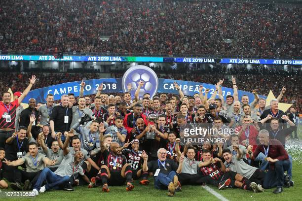 Players of Brazils Atletico Paranaense celebrate after winning the 2018 Copa Sudamericana second leg final football match against Colombia's Junior...