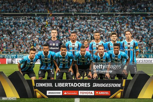 Players of Brazil's Gremio pose for a photo before the start of the Copa Libertadores 2017 football match at the Arena do Gremio stadium in Porto...