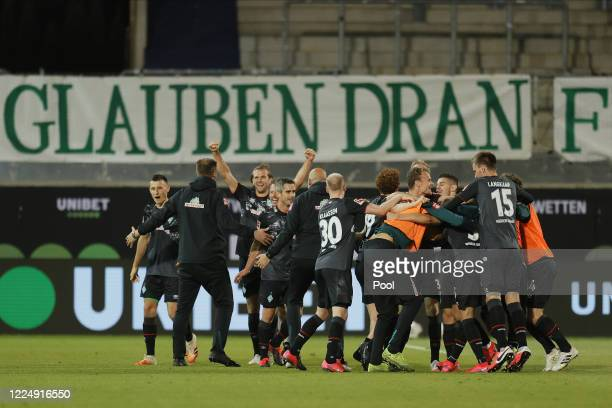Players of Bremen celebrate after the Bundesliga playoff second leg match between 1. FC Heidenheim and Werder Bremen at Voith-Arena on July 6, 2020...