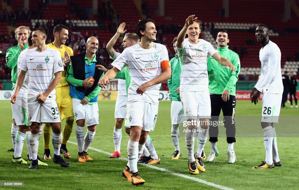 Players of Bremen celebrate after the DFB Cup first round match between Wuerzburger Kickers and SV Werder Bremen at Sparda-Bank-Hessen-Stadion on August 12, 2017 in Offenbach, Germany.