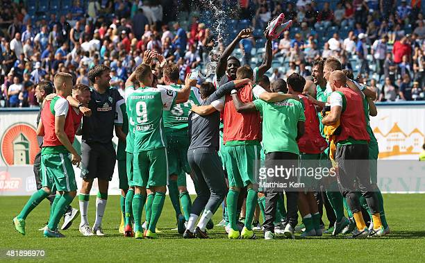 Players of Bremen celebrate after winning the third league match between FC Hansa Rostock and SV Werder Bremen II at Ostseestadion on July 25 2015 in...