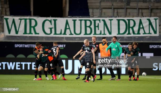 Players of Bremen celebrate victory after the Bundesliga playoff second leg match between 1. FC Heidenheim and Werder Bremen at Voith-Arena on July...
