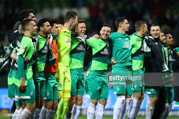 Players of Bremen celebrate victory after winning the Bundesliga match between SV Werder Bremen and FC Augsburg at Weserstadion on February 10 2019...