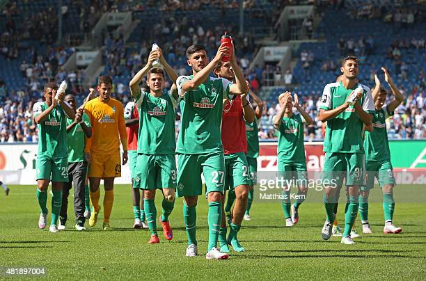 Players of Bremen celebrate with their supporters after winning the third league match between FC Hansa Rostock and SV Werder Bremen II at...