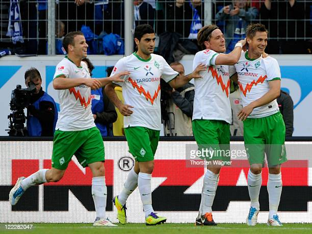 Players of Bremen celebrates after Markus Rosenberg is scoring his teams second goal during the Bundesliga match between TSG 1899 Hoffenheim and SV...