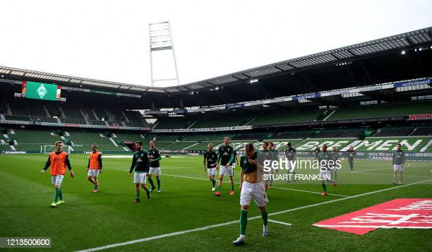 Players of Bremen leave the pitch after the warm up prior to the German first division Bundesliga football match Werder Bremen v Bayer 04 Leverkusen...