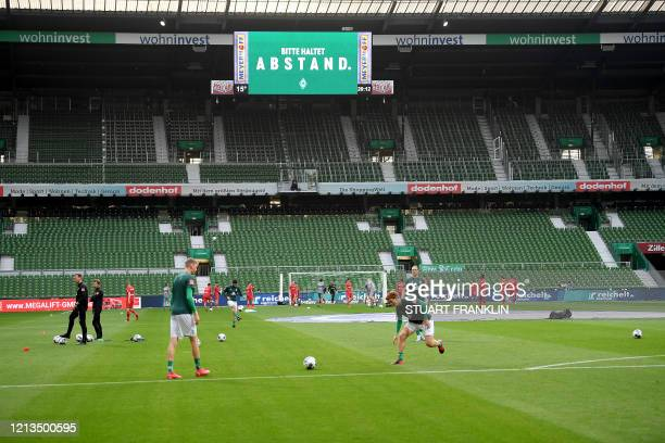 Players of Bremen warm up before the German first division Bundesliga football match Werder Bremen v Bayer 04 Leverkusen on May 18, 2020 in Bremen,...