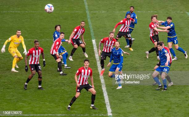 Players of Brentford and Nottingham Forest compete for the ball from a corner during the Sky Bet Championship match between Brentford and Nottingham...
