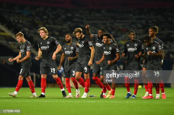 Players of Brentford FC celebrate winning the penalty shootout during the Carabao Cup Third Round match between West Bromwich Albion and Brentford FC...