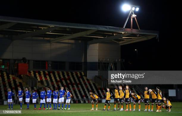 Players of Brighton and Hove Albion and Newport County look on in the penalty shootout during the FA Cup Third Round match between Newport County and...