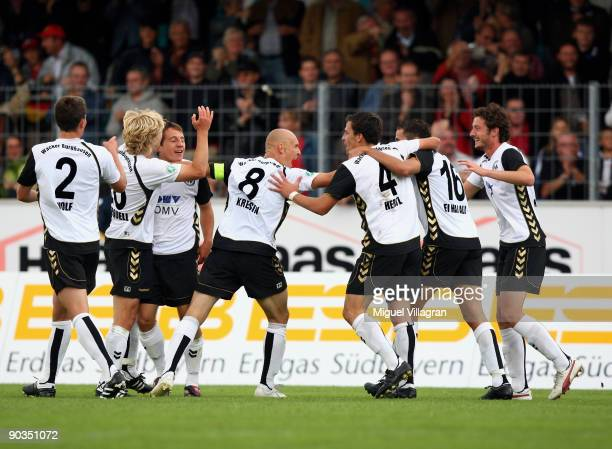 Players of Burghausen celebrate their team's third goal during the 3 Liga match between Wacker Burghausen and SpVgg Unterhaching on September 5 2009...