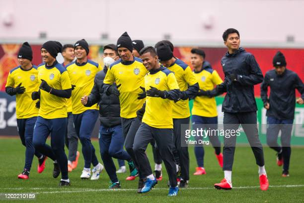 Players of Buriram United warm up during training session prior to the AFC Champions League Preliminary Round match between Shanghai SIPG and Buriram...