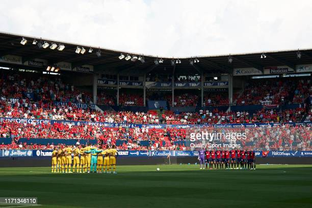 Players of CA Osasuna and of FC Barcelona line up for a minute of silence prior to the Liga match between CA Osasuna and FC Barcelona at Estadio El...