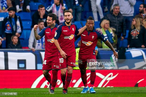 Players of CA Osasuna celebrating their team's first goal during the Liga match between RCD Espanyol and CA Osasuna at RCDE Stadium on December 01,...