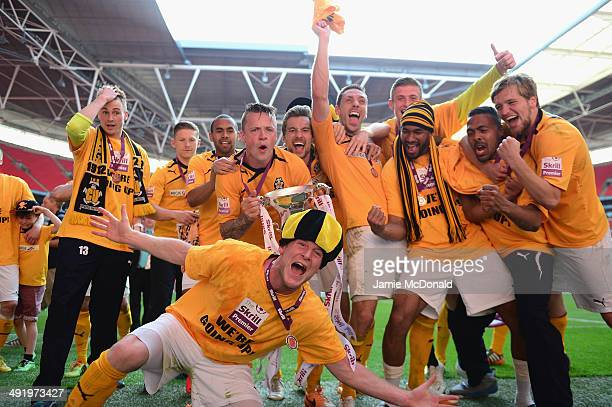 Players of Cambridge United celebrate promotion during the Skrill Conference Premier PlayOffs Final between Cambridge United and Gateshead FC at...