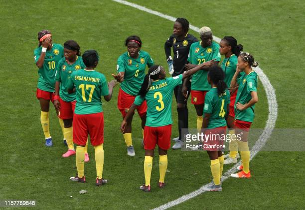 Players of Cameroon argue with referee Qin Liang following England's second goal during the 2019 FIFA Women's World Cup France Round Of 16 match...
