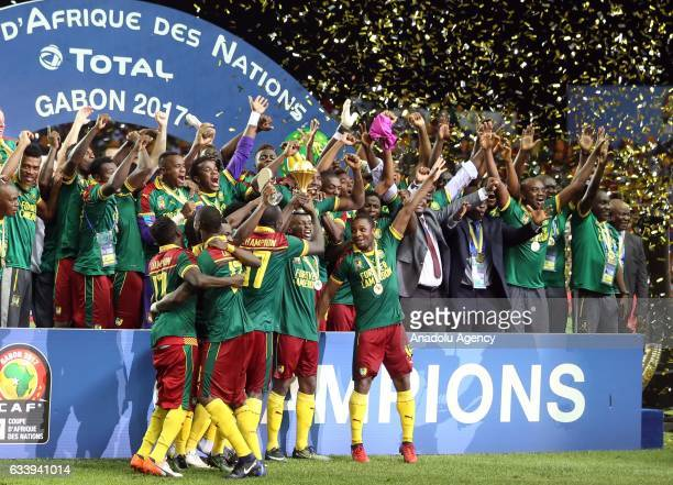 Players of Cameroon celebrate during the awards ceremony after winning the final match against Egypt of 2017 Africa Cup of Nations at the d'Angondje...