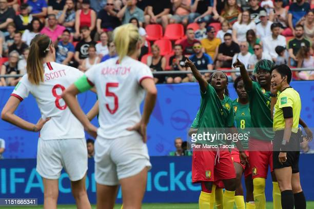 Players of Cameroon speak with referee Qin Liang during the 2019 FIFA Women's World Cup France Round Of 16 match between England and Cameroon at...