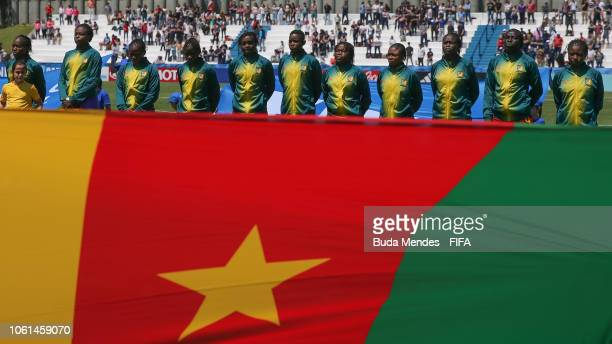 Players of Cameroon team line up for the National Anthem ahead the FIFA U17 Women's World Cup Uruguay 2018 group C match between USA and Cameroon at...