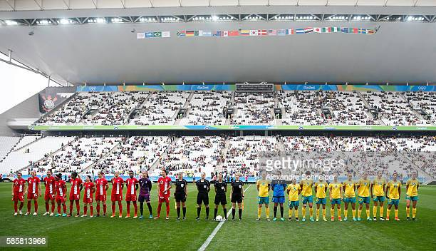 Players of Canada and Australia stand in line for the national anthen before the match between Canada and Australia womens football for the summer...