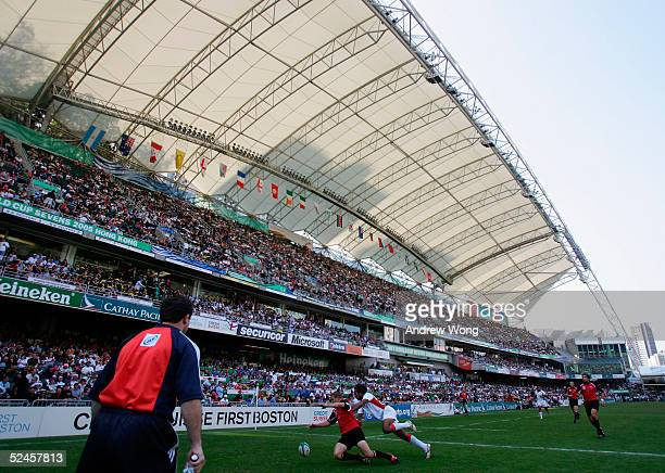 Players of Canada and Tonga in action during their Bowl semifinal match on day three of the Rugby World Cup Sevens held at Hong Kong Stadium March 20...