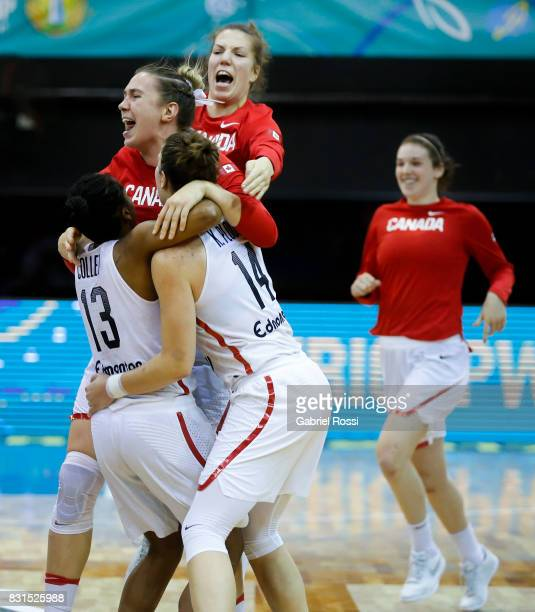 Players of Canada celebrate after winning a match between Argentina and Canada as part of the FIBA Women's AmeriCup Final at Obras Sanitarias Stadium...