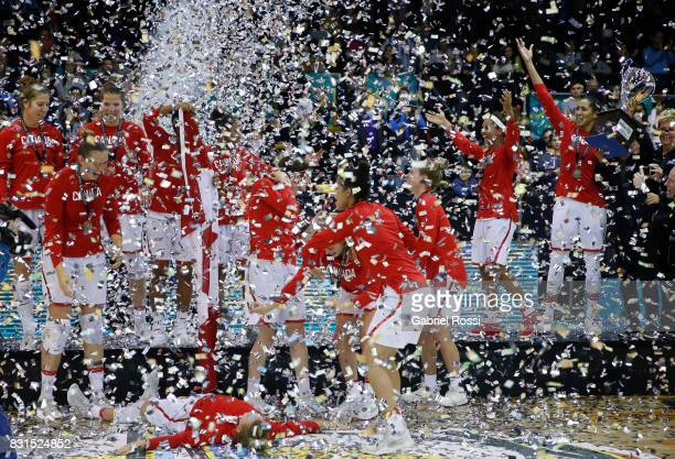 Players of Canada celebrate after winning the match between Argentina and Canada as part of the FIBA Women's AmeriCup Final at Obras Sanitarias...