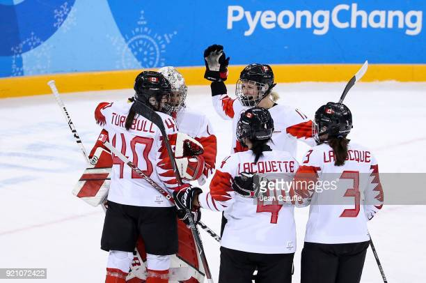 Players of Canada celebrate the victory following the women's semifinal ice hockey match between Canada and Olympic Athletes from Russia at Gangneung...