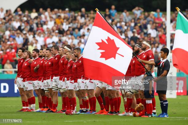 Players of Canada participate in their national anthem during the Rugby World Cup 2019 Group B game between Italy and Canada at Fukuoka Hakatanomori...