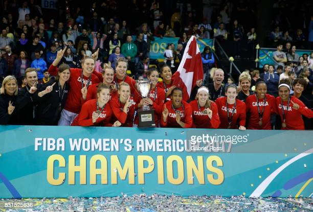 Players of Canada pose with the trophy for a group photo after winning the match between Argentina and Canada as part of the FIBA Women's AmeriCup...