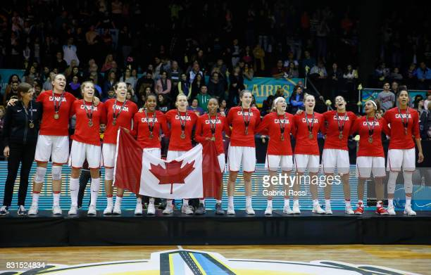Players of Canada sing their national anthem after winning the match between Argentina and Canada as part of the FIBA Women's AmeriCup Final at Obras...