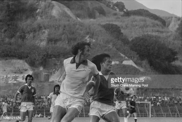 Players of Caroline Hill and Yuen Long fight for a ball during their league game at the Police Ground Stadium Yuen Long won 10 07NOV77