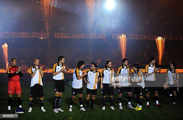 Players of Catalunya chat prior to the start of the international friendly match between Catalunya and Argentina at the Camp Nou stadium on December...