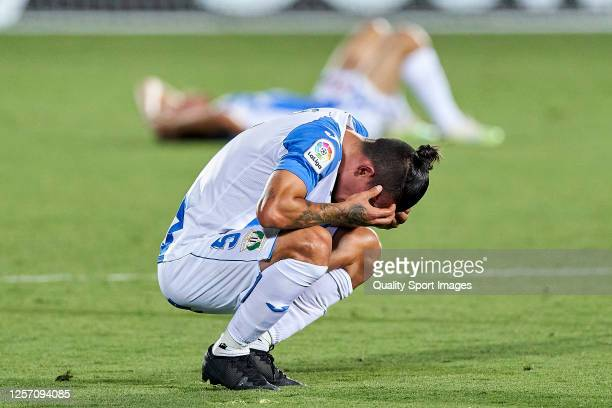 Players of CD Leganes react as they are relegated from La Liga after the Liga match between CD Leganes and Real Madrid CF at Estadio Municipal de...
