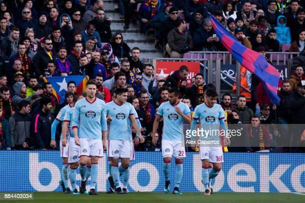 Players of Celta de Vigo celebrate after their teammate Iago Aspas scored the opening goal during the La Liga match between FC Barcelona and Celta de...