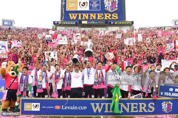 Players of Cerezo Osaka celebrate as captain Yoichiro Kakitani lifts the trophy after the JLeague Levain Cup final match between Cerezo Osaka and...