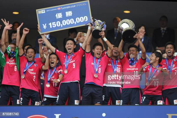Players of Cerezo Osaka celebrate as captain Yoichiro Kakitani lifts the trophy after the J.League Levain Cup final match between Cerezo Osaka and...