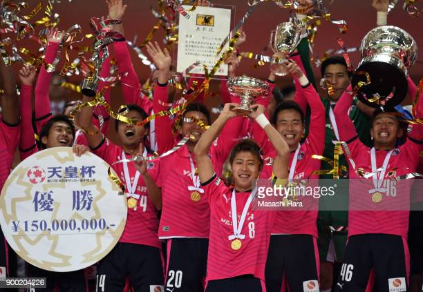 Players of Cerezo Osaka celebrate as captain Yoichiro Kakitani lifts the trophy after the 97th All Japan Football Championship final between Cerezo...