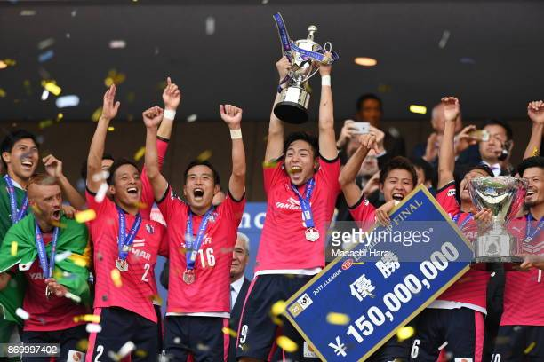 Players of Cerezo Osaka celebrate as Kenyu Sugimoto lifts the trophy after the J.League Levain Cup final match between Cerezo Osaka and Kawasaki...
