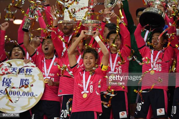Players of Cerezo Osaka celebrate their victory as captain Yoichiro Kakitani lifts the trophy after the 97th All Japan Football Championship final...