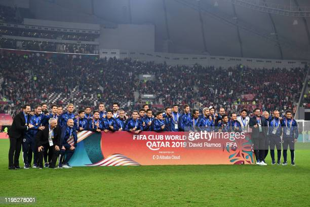 Players of CF Monterrey pose for a photo with their medals for third place following the FIFA Club World Cup Qatar 2019 Final match between Liverpool...