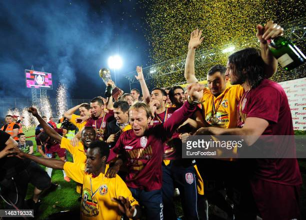 Players of CFR 1907 Cluj on the podium with the trophy as they celebrate winning the league after the Romanian Liga 1 match between CFR 1907 Cluj and...