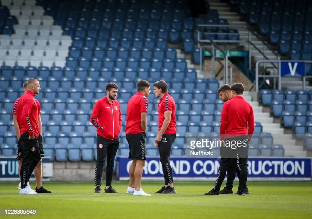 LONDON ENGLAND SEPT Players of Charlton Athletic Football Club inspect the pitch ahead of the game during the EFL Trophy match between AFC Wimbledon...