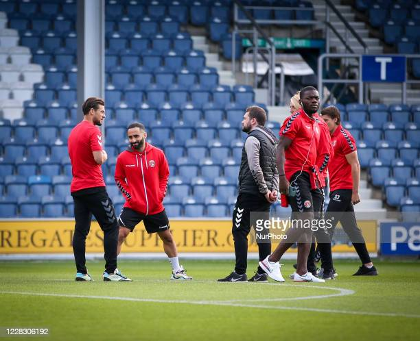 Players of Charlton Athletic Football Club inspect the pitch ahead of the game during the EFL Trophy match between AFC Wimbledon and Charlton...
