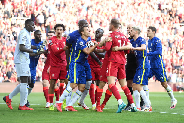 Players of Chelsea and Liverpool clash as Reece James of Chelsea is sent off, leading to a penalty and the first goal for Liverpool scored by Mohamed...