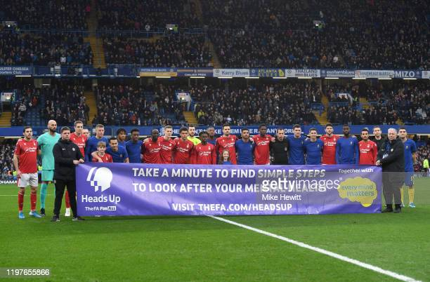Players of Chelsea and Nottingham Forest pose for a photograph showing support of the Heads Up Campaign prior to the FA Cup Third Round match between...